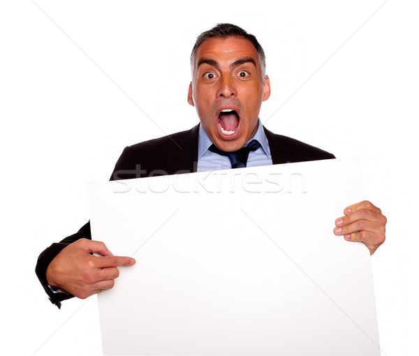 Businessman screaming and pointing a card Stock photo © pablocalvog