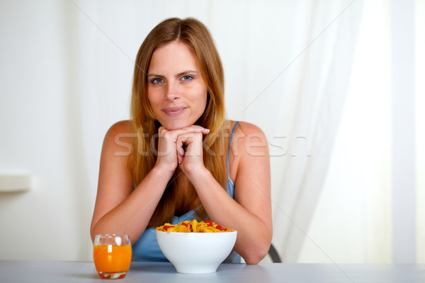 Relaxed pretty young woman at breakfast Stock photo © pablocalvog