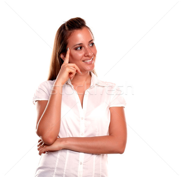 Stylish reflective young woman looking to her left Stock photo © pablocalvog