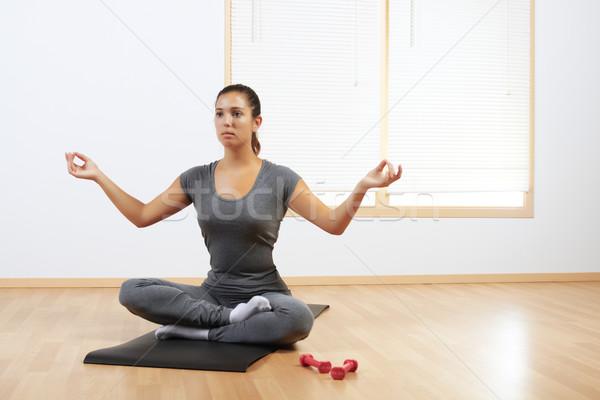 woman doing yoga at home Stock photo © pablocalvog