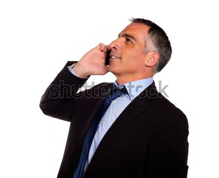 Hispanic professional man conversing with a mobile Stock photo © pablocalvog
