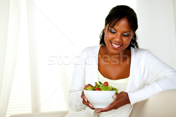 Young woman looking to a green salad bowl Stock photo © pablocalvog