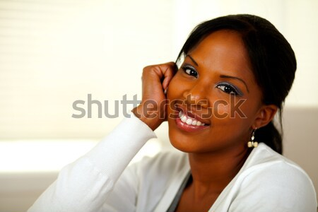 Relaxed afro-american young woman smiling Stock photo © pablocalvog