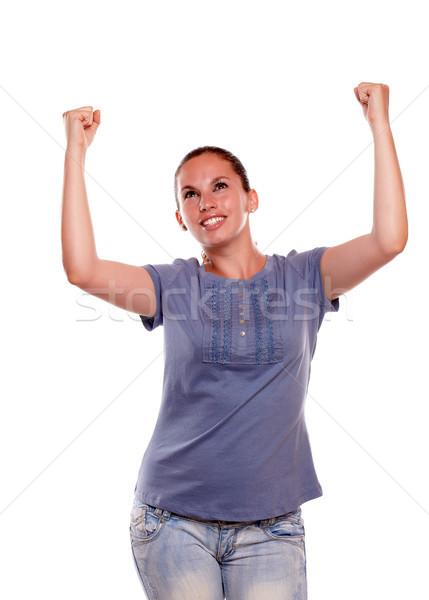 Stockfoto: Opgewonden · jonge · vrouwelijke · vieren · overwinning · Blauw