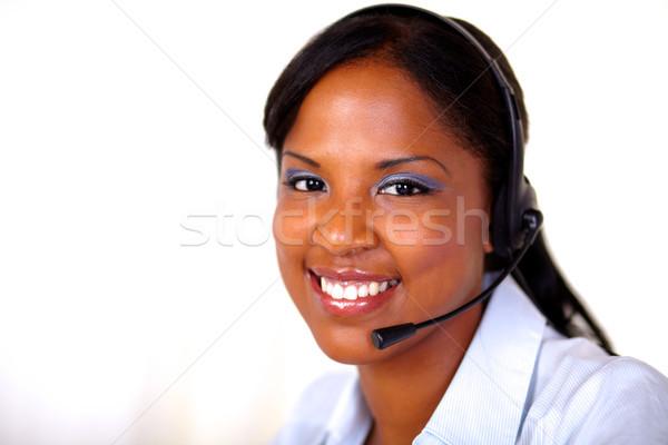 Recepcjonista patrząc słuchawki mikrofon przestrzeni pracy Zdjęcia stock © pablocalvog