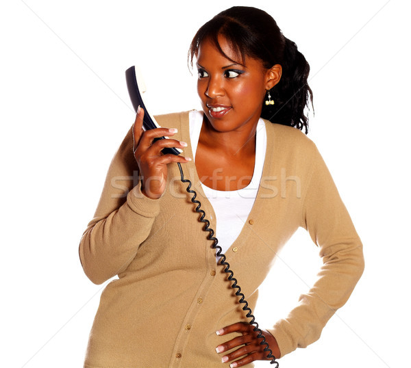 Surprised young woman looking to phone handset Stock photo © pablocalvog