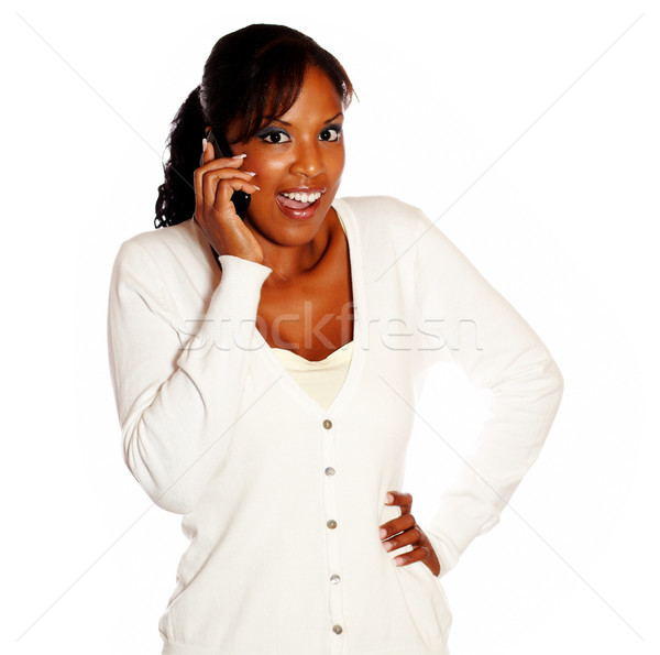 Surprised young woman conversing on mobile phone Stock photo © pablocalvog
