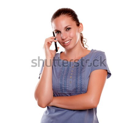 Smiling young woman looking at you on cellphone Stock photo © pablocalvog