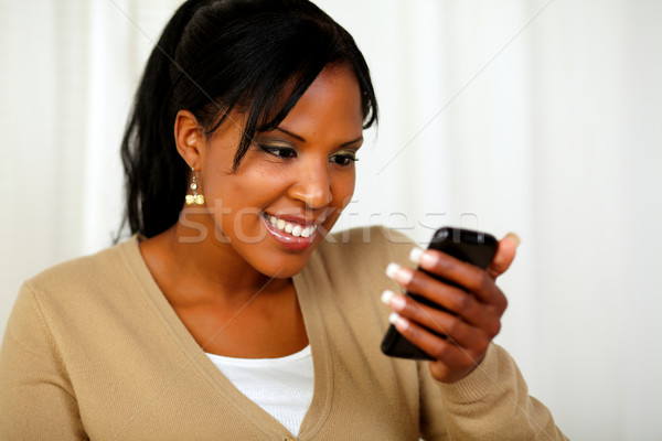 Afro-american young woman sending a message Stock photo © pablocalvog