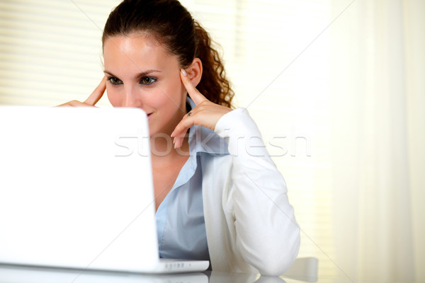 Pensive attractive woman browsing the internet Stock photo © pablocalvog
