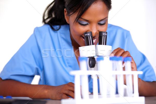Encantador científico menina microscópio laboratório mulher Foto stock © pablocalvog
