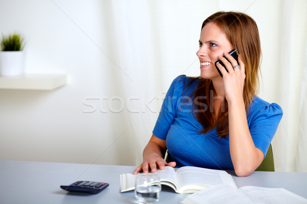 Charming blonde lady talking on mobile phone Stock photo © pablocalvog