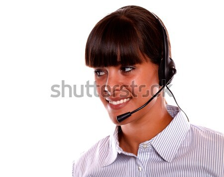 Smiling young woman using earphone looking right Stock photo © pablocalvog