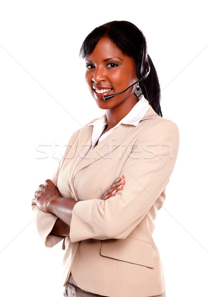 Smiling young woman wearing a headset Stock photo © pablocalvog