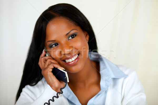 Stock photo: African woman conversing on phone