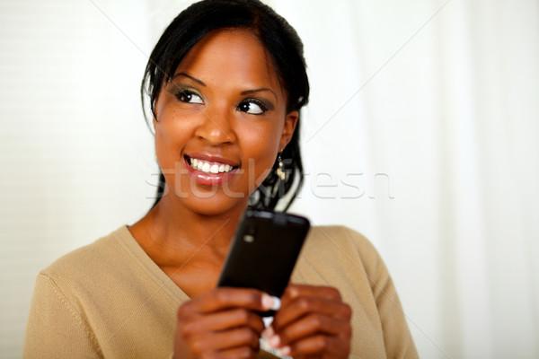 Stock photo: Friendly black woman sending a message