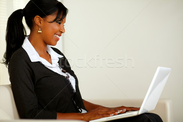 Beautiful business black woman reading on laptop Stock photo © pablocalvog
