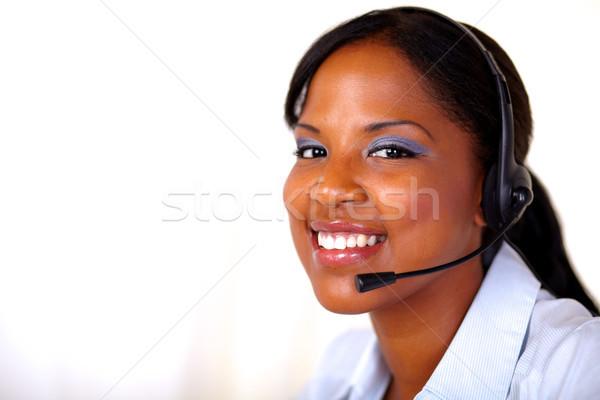 секретарь улыбаясь наушники микрофона пространстве рабочих Сток-фото © pablocalvog