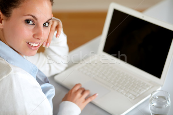 Young woman looking at you browsing the internet Stock photo © pablocalvog