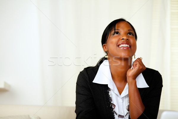Happy afro-american woman looking up Stock photo © pablocalvog