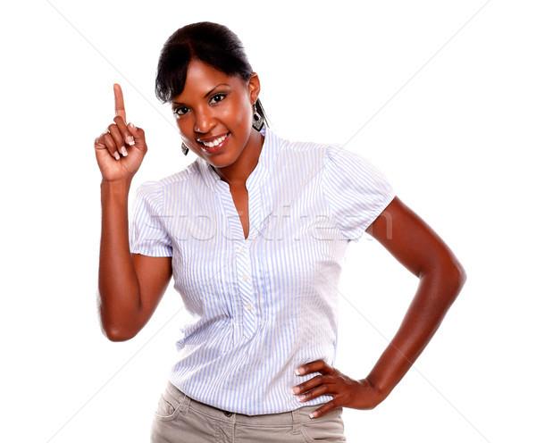 Séduisant jeune femme pointant up regarder femme Photo stock © pablocalvog