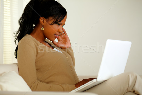 Young woman with headache working on laptop Stock photo © pablocalvog