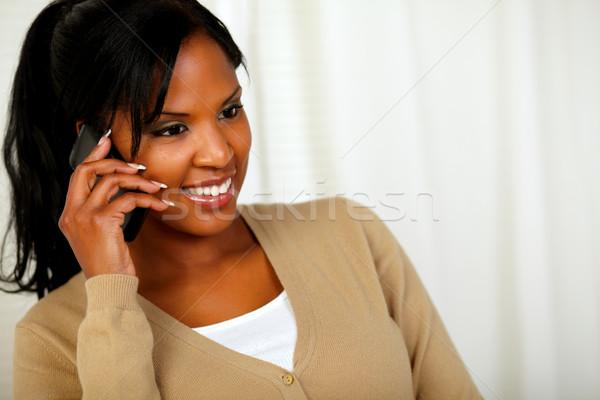 Güzel siyah kadın cep telefonu portre ev güzellik Stok fotoğraf © pablocalvog
