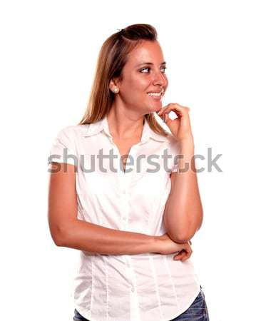Charming positive young woman looking to her left Stock photo © pablocalvog