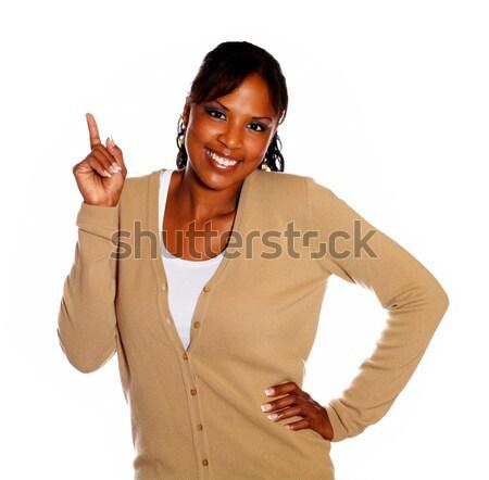 Gyönyörű fiatal nő közmondás hívj fel kéz kék Stock fotó © pablocalvog