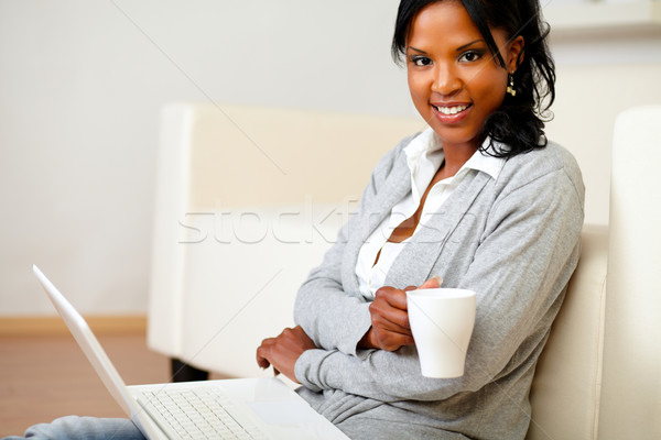 Young woman with a mug looking to you Stock photo © pablocalvog