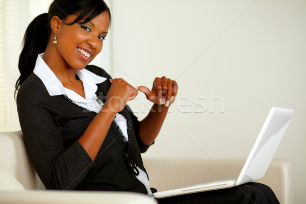 Stock photo: Beautiful young business woman working on laptop