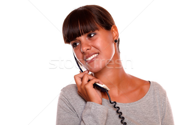 Young woman conversing on phone looking to right Stock photo © pablocalvog
