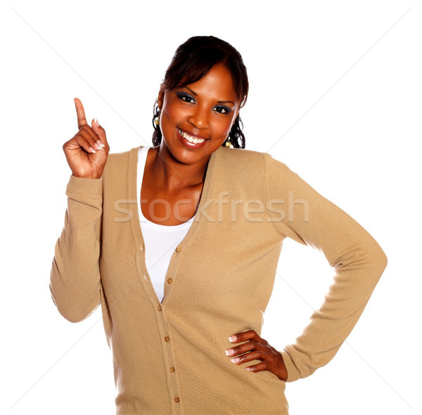 Lovely young woman pointing up looking at you Stock photo © pablocalvog