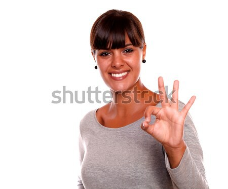 Smiling young woman saying great job with her hand Stock photo © pablocalvog