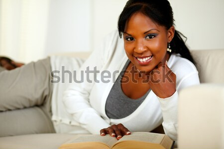 Afro-american young woman reading on laptop screen Stock photo © pablocalvog