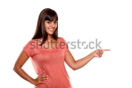 Charming smiling young woman with the palm upward Stock photo © pablocalvog