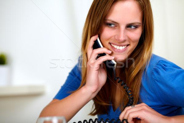 Smiling caucasian blonde girl on phone Stock photo © pablocalvog