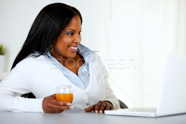 Pretty young woman looking having fun on laptop Stock photo © pablocalvog