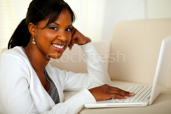 Stock photo: Young woman looking at you browsing the Internet