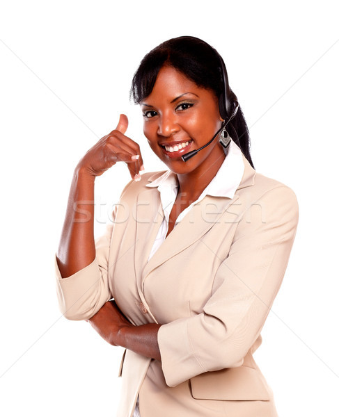 Attractive ethnic receptionist wearing headset Stock photo © pablocalvog