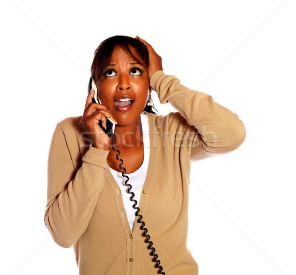 Surprised female conversing on phone and screaming Stock photo © pablocalvog