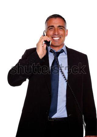 Charyzmatyczny biznesmen śmiechem telefonu portret odizolowany Zdjęcia stock © pablocalvog