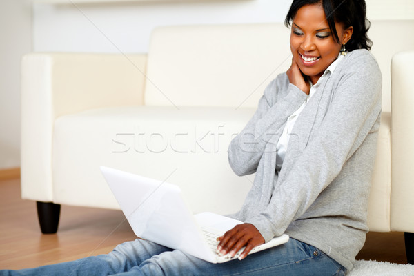 Young woman smiling and browsing the Internet Stock photo © pablocalvog