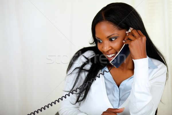 Young lovely girl conversing on phone Stock photo © pablocalvog