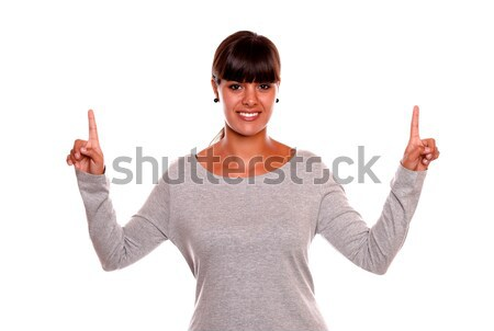 Attractive young woman showing you victory sign Stock photo © pablocalvog