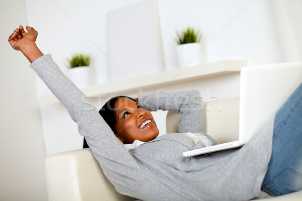 Afro-american woman browsing the Internet Stock photo © pablocalvog