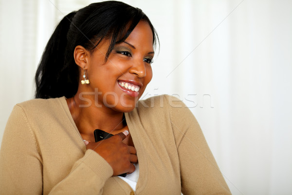 Stock photo: Young girl excited about a message from the mobile