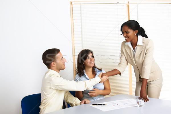 Jovem pessoas de negócios multinacional grupo escritório Foto stock © pablocalvog