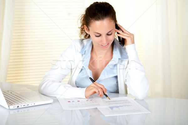 Young businesswoman working at office Stock photo © pablocalvog