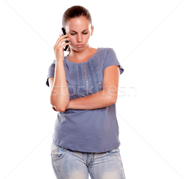 Serious young woman speaking on mobile phone Stock photo © pablocalvog